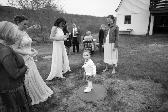 Guests enjoy the yard at Jonna and Heather's Inn at West Settlement Wedding by Karen Hill Photography