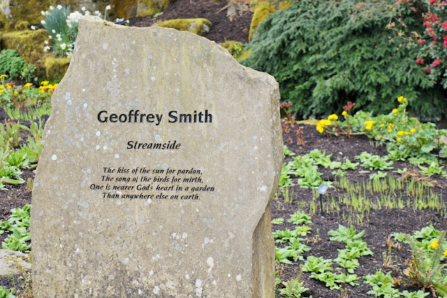 a stone with a poem in the garden at rhs. 'the kiss of the sun for pardon, the song of the birds for mirth, one is nearer God's heart in a garden than anywhere else on earth.