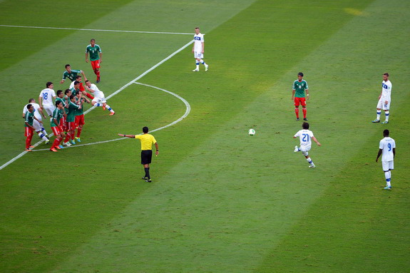 Italy player Andrea Pirlo scores the opening goal against Mexico from a free-kick