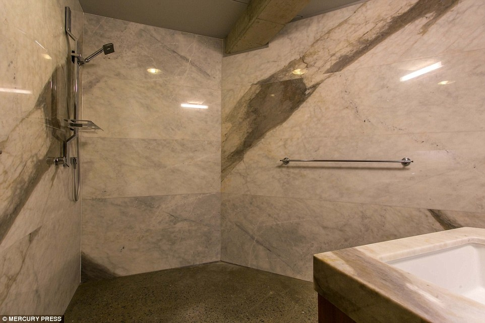 04-Bathroom-and-shower-room-Charles-Wright-Architecture-with-Star-Wars-Millennium-Falcon-Inspired-House-www-designstack-co