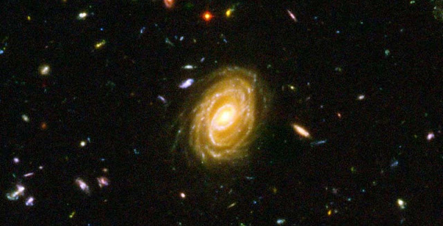 An image of distant galaxies forming stars. Credit: NASA, ESA and Bahram Mobasher