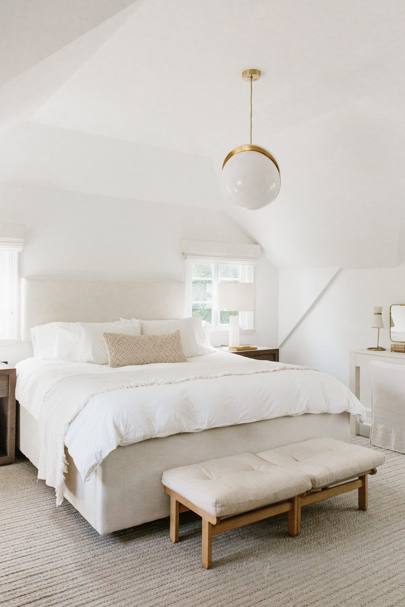 Erin Fetherston's serene white bedroom with linen and modern lighting. Come explore California modern farmhouse interior design inspiration! #bedroomdecor #whitebedrooms #interiordesign #modernfarmhouse #zen #serenedecor