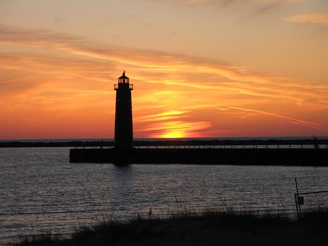Beach and Light House at Sunset on Lake Michigan