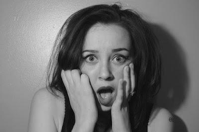 woman express shock