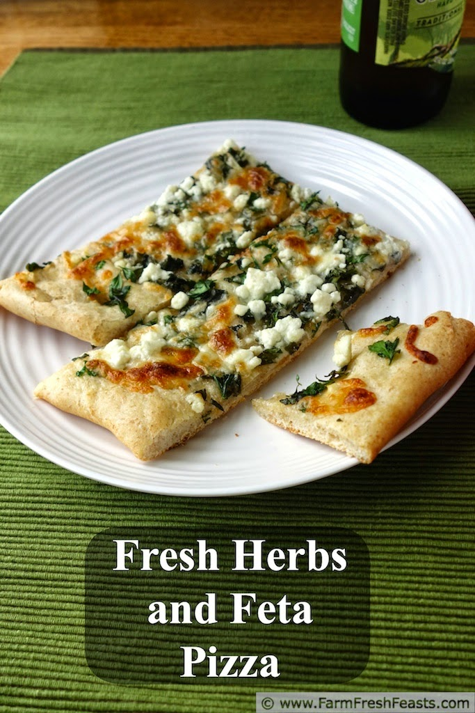 A mix of fresh herbs and a blend of tangy cheeses on roasted garlic oil for a light summer pizza.