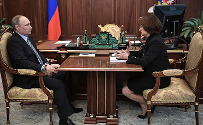 Vladimir Putin and Central Bank Governor Elvira Nabiullina.