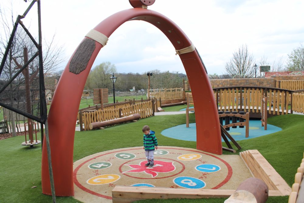 boy-standing-in-interactive-playground