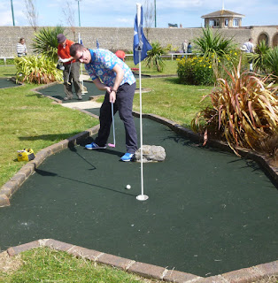 Photo of Richard Gottfried playing the 18th hole at Splash Point Mini Golf course in Worthing