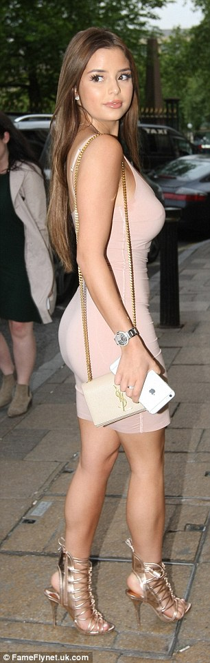 Demi Rose flaunts her ample cleavage in a thigh-skimming bodycon dress