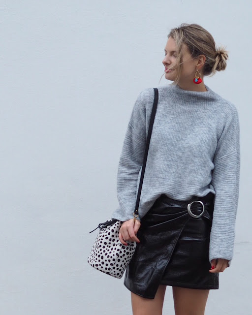 leather skirt, Baia bucket bag, bell sleeved jumper, grey knitted jumper