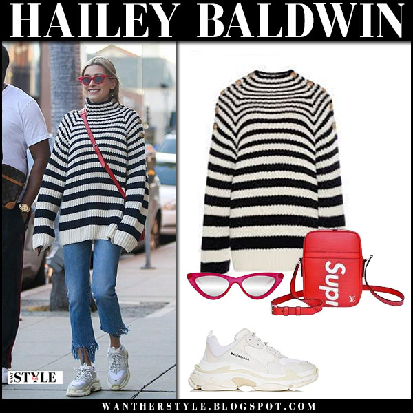 Hailey Baldwin in striped knit alberta ferretti sweater, jeans and white sneakers balenciaga street fashion march 25