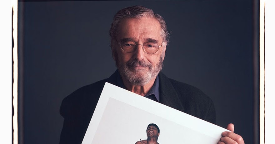 17 Fantastic Portraits of Famous Photographers Posing With Their Iconic Images