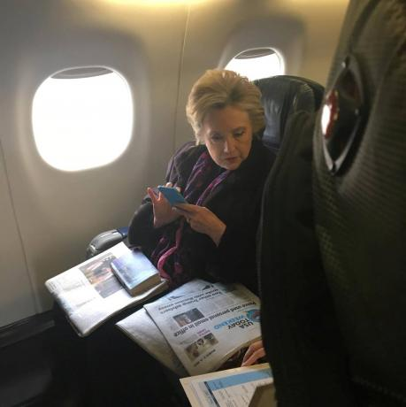 "Former Democratic presidential candidate Hillary Clinton was on an airplane traveling from Boston during her flight on American Airlines to Laguardia airport in New York Cityon Friday when a fellow passenger snapped a photo of her glancing down at Friday's USA Today newspaper front page headline ""Pence used personal email in office."""