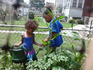 Little Green Thumbs helping in the Garden