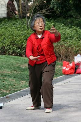 Elderly Lady Enjoys Tai Chi Practice in Shanghai