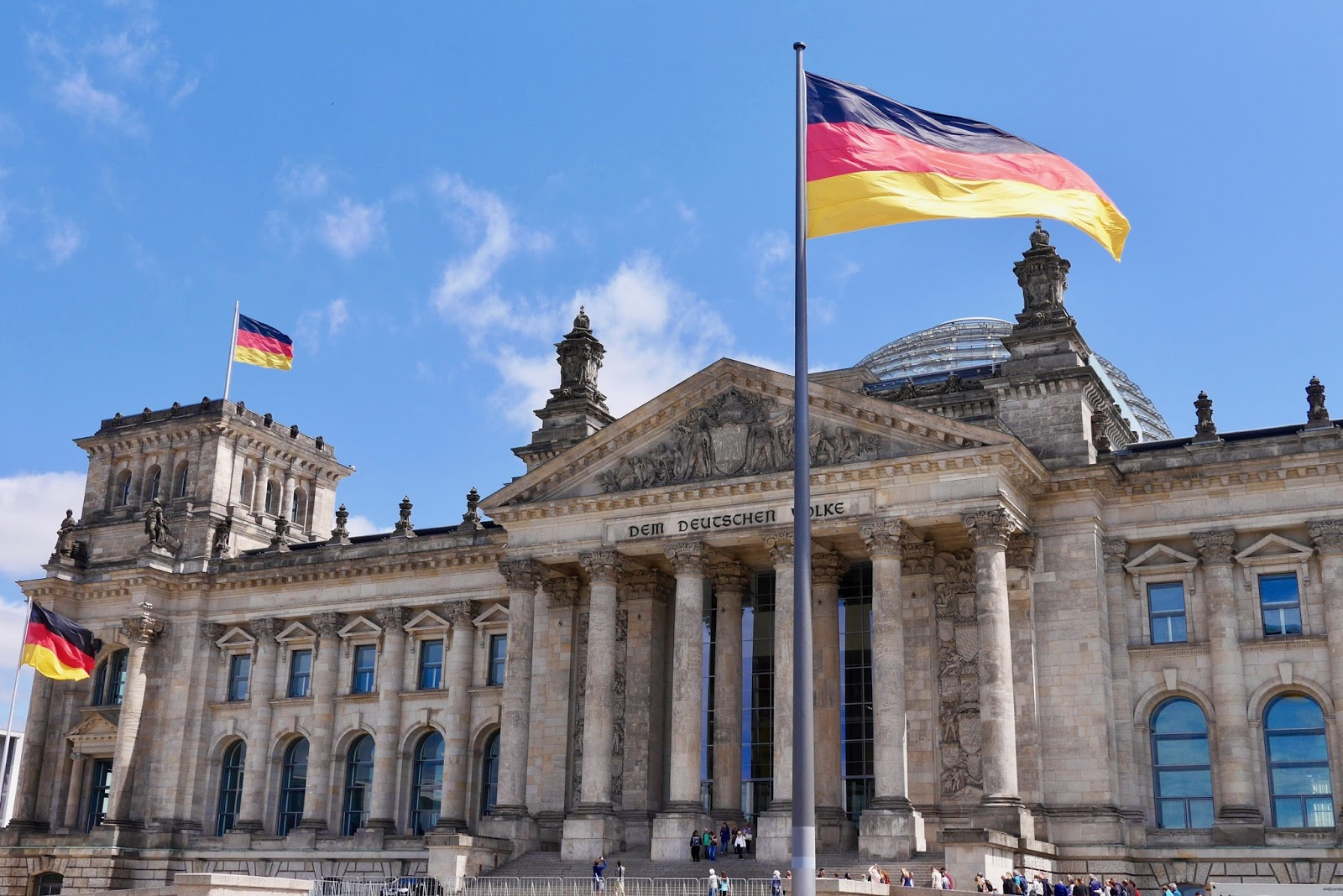 Outside the Reichstag building in Berlin with huge flags, by www.CalMcTravels.com. Cal McTravels