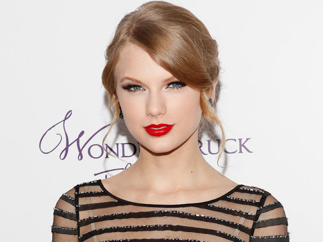 http://tigerbeat.com/2014/05/taylor-swift-talks-about-her-signature-red-lipstick-look/