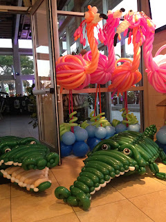 Flamingo balloon sculpture and alligator balloon sculptures