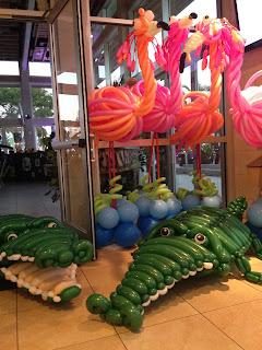 Flamingo balloon sculpture and alligator balloon sculptures
