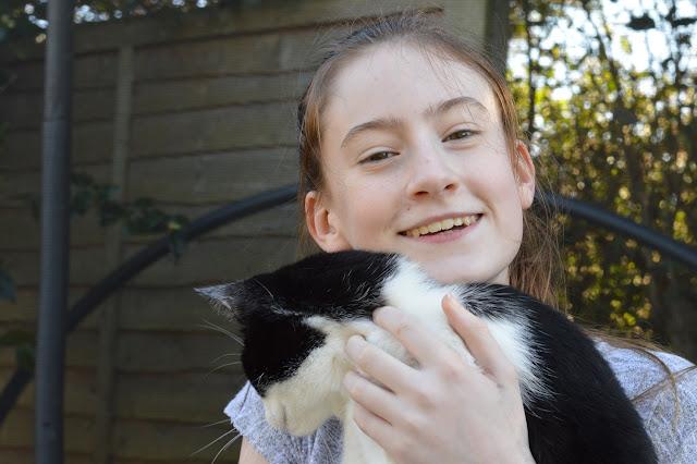 Tamsin hugging cat
