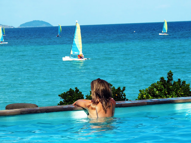 girl in infinity pool with sea views hamilton island