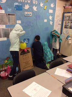 These students had the bright idea to stand against the blue wall in order to camouflage better with their surroundings.