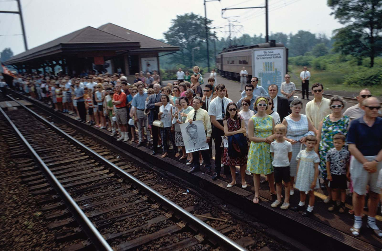 The funeral train rolls through Princeton Junction, New Jersey, on June 8, 1968. Several people hold portraits of Robert F. Kennedy, including a man whose poster reads
