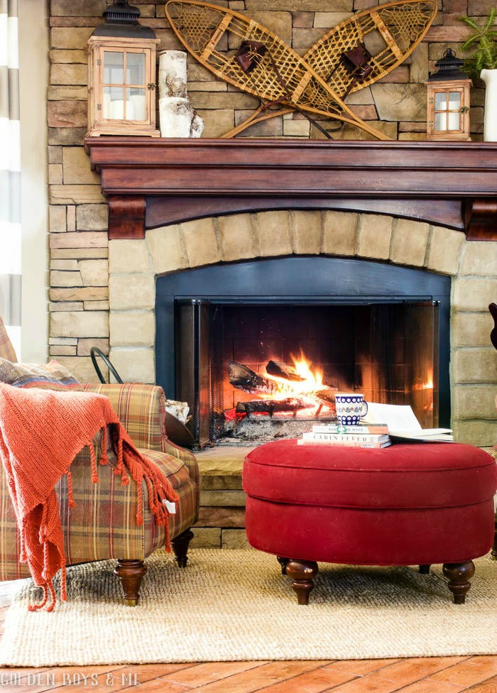 Snowshoe winter mantel decor on stone fireplace