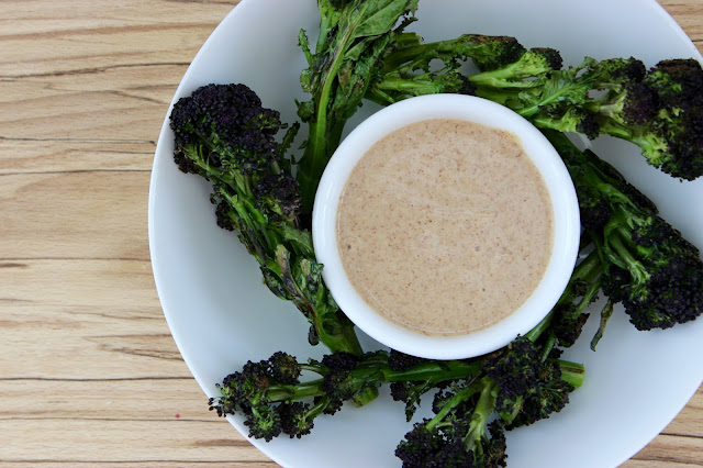 Purple sprouting broccoli spears with peanut satay dipping sauce