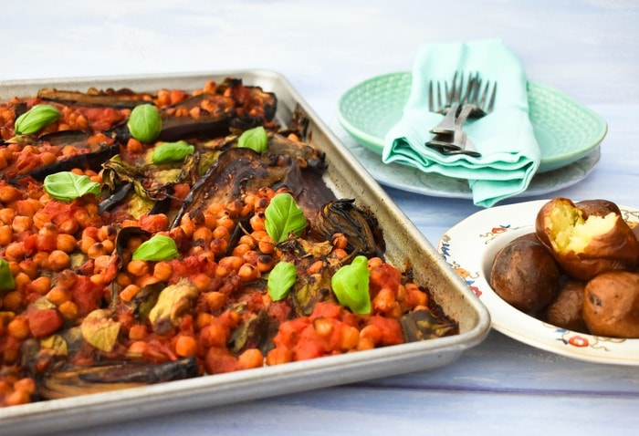 Sheet Pan Aubergine (Eggplant) & Chickpea Bake served with mini roast potatoes