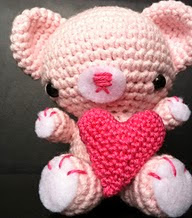 http://yarnplanet.tumblr.com/post/42592192162/so-i-made-a-valentines-day-bear-its-look-was