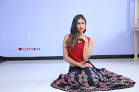 Telugu Actress Nishi Ganda Stills in Red Blouse and Black Skirt at Tik Tak Telugu Movie Audio Launch .COM 0113.JPG