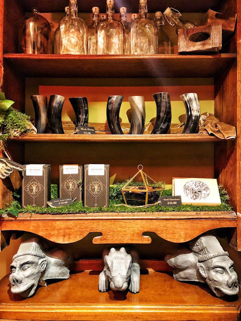 Display and gift shop at the Cauldron featuring Gargoyles and potions bottles
