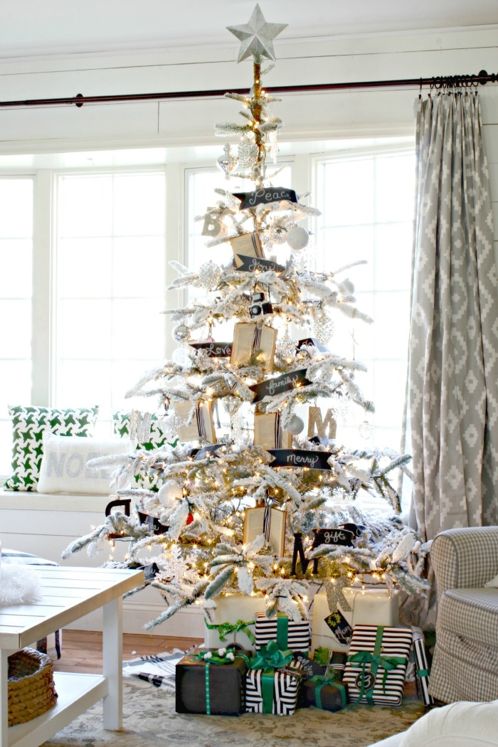 Flocked Christmas tree with black and white accents and book ornaments - www.goldenboysandme.com