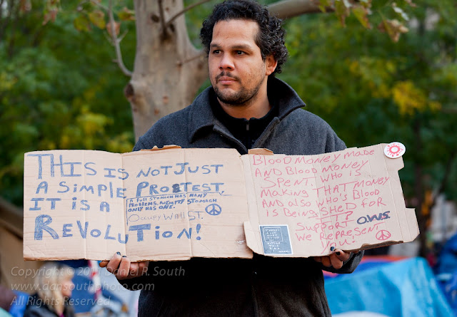a photo of an occupy wall street demonstrator in new york
