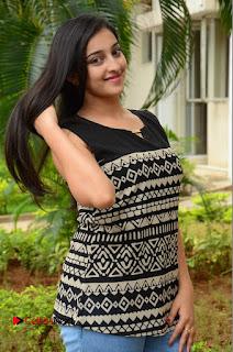 Actress Mouryani Pictures in Denim Jeans at Ardhanari Movie Success Meet  0103.JPG