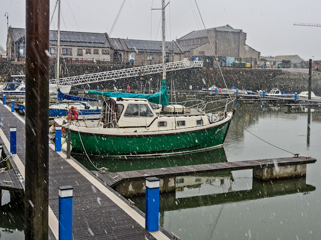 Photo of snow falling at Maryport Marina in Cumbria