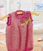 http://www.letsknit.co.uk/free-knitting-patterns/girls_knitted_pinafore_dress