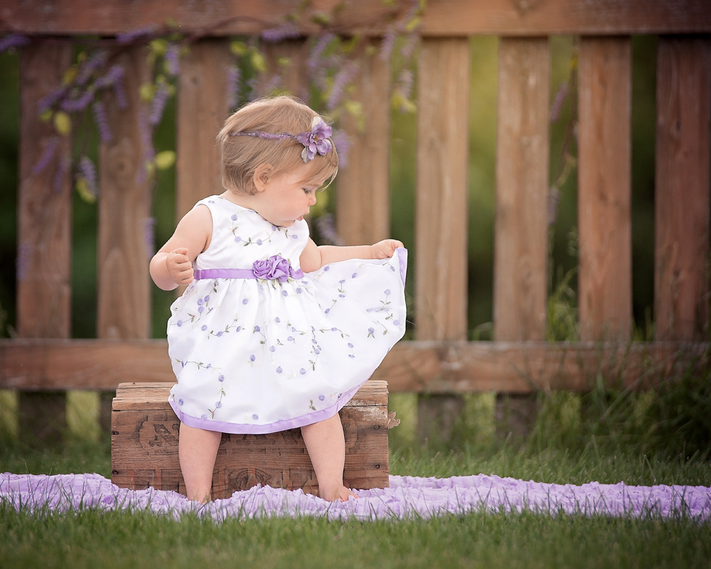 One year old little girl cake smash one year milestone session