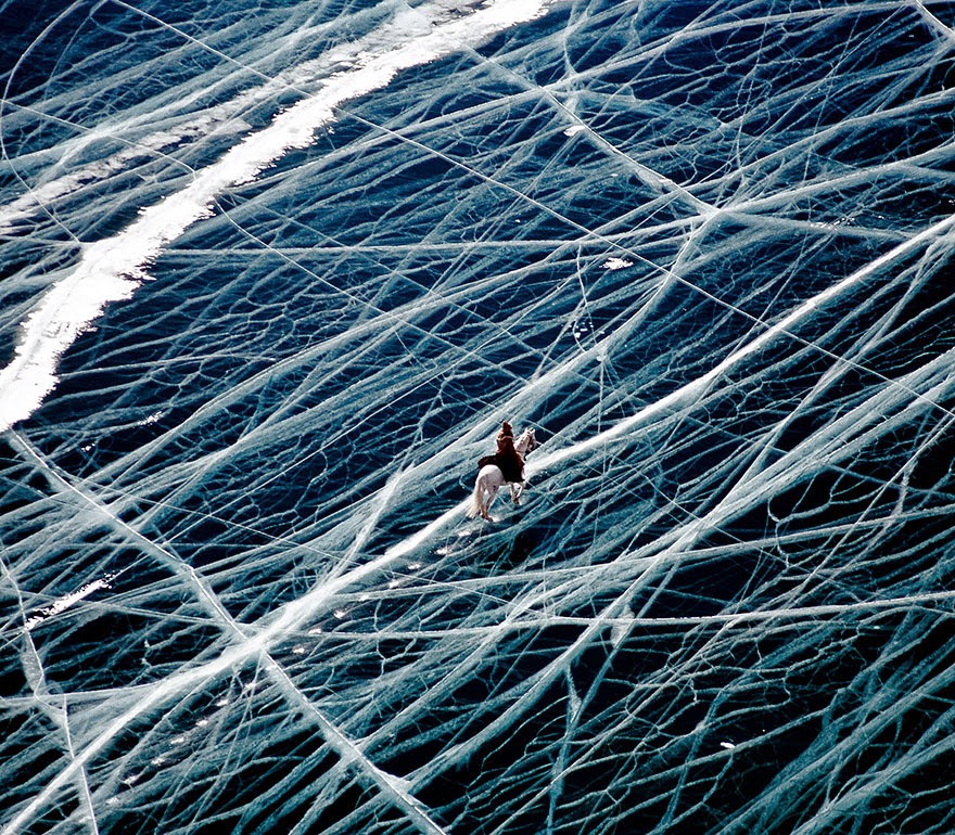 5. Ice Rider In Siberia, Russia - 18 Beautiful Frozen Lakes, Oceans And Ponds That Resemble Fine Art