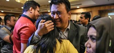 Nine Malaysians freed by North Korea arrive home