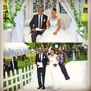 A couple making their entrance into a wedding gazebo at the Agodi gardens