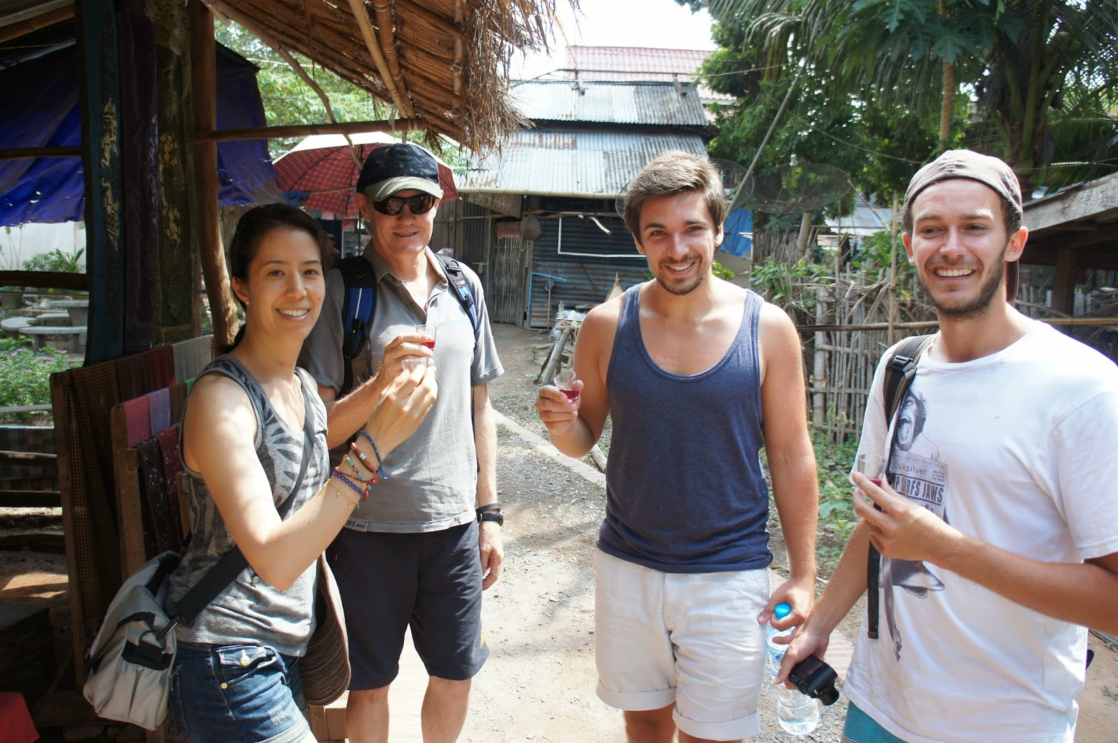 Luang Prabang - Bottoms up! Sampling some wine with our excursion mates Dominic and Max