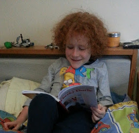 six year old reading funny children's book
