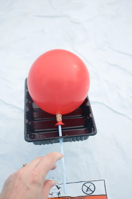 Inflate the Balloon and hold the straw shut until ready to go