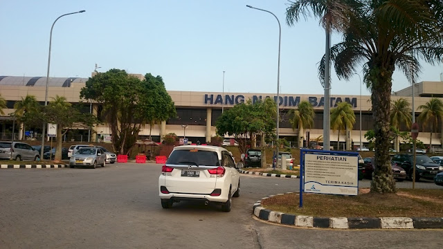 Batam Airport is seen from car parking area - Image: Author