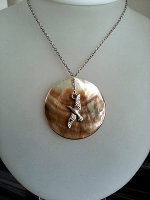 https://www.etsy.com/listing/161938078/2-way-shell-disc-necklace-with-seagull?ref=favs_view_3