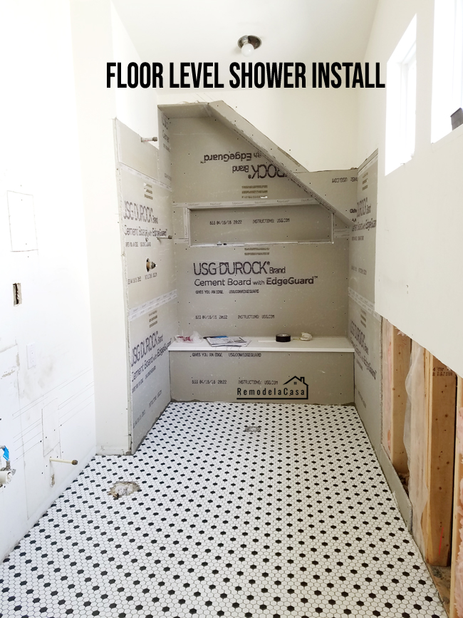 Small bathroom renovation where a walk-in shower replaced a dated bath shower combo