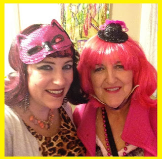 Bridget Eileen with her mom, both in costume to attend a Mardi Gras ball in New Orleans
