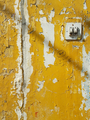 A Minimalist Photo of electric switch on yellow textured wall shot by Samsung Galaxy S6 Smart Phone